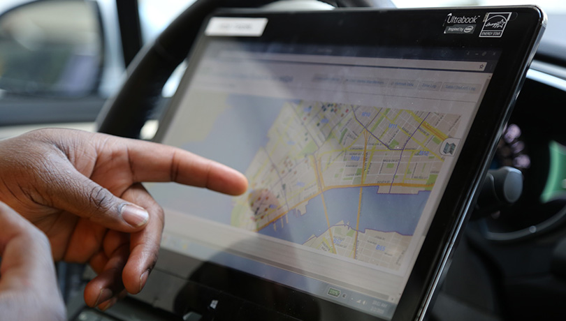 Person pointing to a map on a tablet